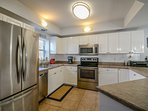 Fully equipped kitchen with stainless steel appliances and everything to prepare your favorite island dish.