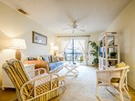 Decorated with Florida style, the living room features a TV, VCR, DVD and sofa sleeper.