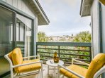 Sit back and relax and enjoy the Florida sunshine on the private balcony.