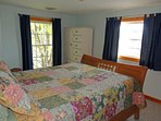 Upstairs Bedroom #2 with queen size bed and plenty of storage for your belongings.