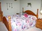Spacious master bedroom with king sized bed, TV, VCR and private bath.