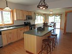 Kitchen island with seating for 3 people. Kitchen is fully equipped for your stay.