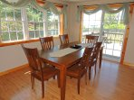 Dining Room table with seating for 6. Sliding glass doors open onto a large deck and private yard.