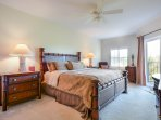 Spacious master bedroom with king size bed, flat screen TV, access to the balcony and private master bath.