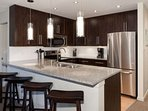 Granite counter tops, stainless steel full size appliances, 4 bar stools to oversized island