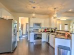 The spacious, fully equipped kitchen features modern stainless steel appliances, which you'll use to whip up...