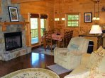 Living Room w/stone fireplace & great views