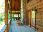 Covered wrap-around deck with river views