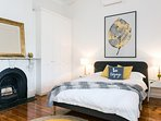 Large queen bedroom, high ornate ceiling, original wooden floors & fireplace.