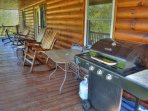 Great Covered deck with rocking chairs & gas grill