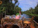 Back Deck, enjoying morning bite with river lancsape of Bornean rainforest