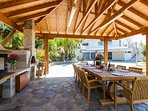 Fully equipped BBQ area with dining table under the pergola