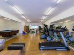 Gym area with a wide selection of fitness equipment