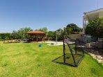 Spacious lawn garden with playground area