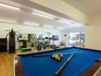 A 120m² play room with HDTV, gym, pool table, table tennis and a piano