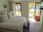 The upstairs main bedroom leading onto a patio overlooking Cape Town Harbour.