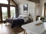 Kind size bed, beautiful bedside chests, bespoke blackout curtains and a spectacular view.