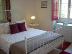 Enjoy a good night's sleep in the light and airy main bedroom with its large, comfortable double bed