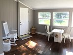 Front porch with rocker, books and checker board table, a great place to enjoy the sunset!