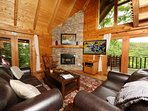 Cozy Living Room with Large Flat Screen TV and Gas Fireplace