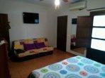 Habitacion de matrimonio cama articulada de 180 de ancho, sofa  ,aire acondicionado ventilador y tv