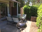 Patio with table, chairs, and grill