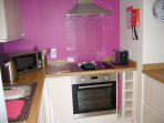 Kitchen with brand new modern appliances, fixtures and fittings.
