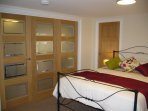 Bi-fold doors closed for privacy but still keeping bedroom light and spacious.