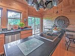 An expansive fully equipped kitchen has everything you'll need to whip up mouth watering meals.