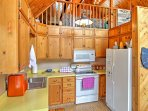 Enjoy a good home-cooked meal during your stay with this fully equipped kitchen.