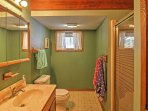 This full bathroom is equipped with a walk-in shower.