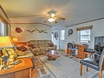 The comfortable living room features plush couches and a flat-screen TV.