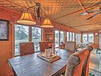 Dine with a view at the large dining table, directly adjacent to the kitchen.