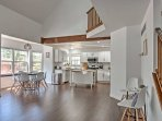 The living room flows seamlessly into the kitchen and dining area.