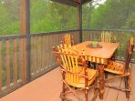 Enjoy outdoor dining in the tree tops on the screened in upper deck.