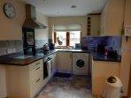 Kitchen incorporating fridge, freezer, washing machine, dish washer & cooker,