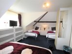Bedroom 3 with Freeview TV 1 double bed and 2 single beds sleeps 3