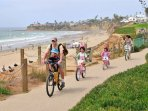 San Diego Pacific Beach Boardwalk - Lots of action, people playing volleyball, skateboarding, biking