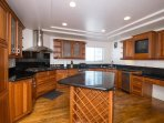 fully functional and considerably equipped kitchen with a full-sized ref, microwave, toaster, oven