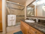 athroom with shower and toilet. Essentials like toilet paper, shampoo, conditioner are provided.