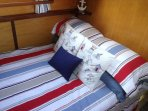 Aft Cabin has a comfortable  double bed (4ft X 6ft), wardrobe. Hairdryer also supplied.