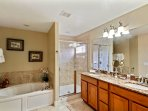 Main Master Ensuite with granite double sinks and walk in shower, toilet and huge master closet.