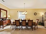 Large dining room table that seats 8 comfortably for a more formal dining experience.