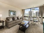 Living Room and Dining Area With Floor To Ceiling Mountain Views