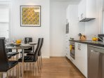 Modern fully equipped kitchen with fully size appliances.