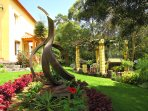 Sculpture-Freedom and Flight by Eduino Sousa, master sculptor in the cottage #3 gardens