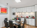 Modern fully equipped kitchen with full size appliance and dining table for 6.
