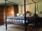 The 1850's Anglo–Indian four-poster in the Tabor Room.