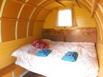 The double bed area inside the gypsy caravan.
