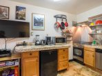 Fully equipped kitchen w/ stove top oven, dishwasher, toaster oven, coffee maker & refrigerator.